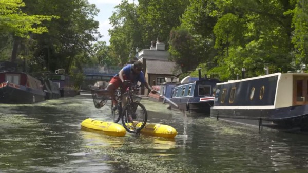 The man who fishes for plastic from a floating bicycle